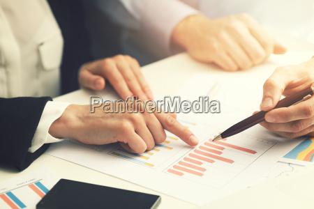 business people working with financial report