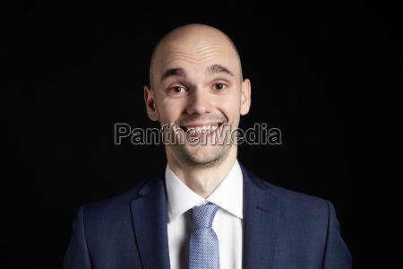 surprised man on black background