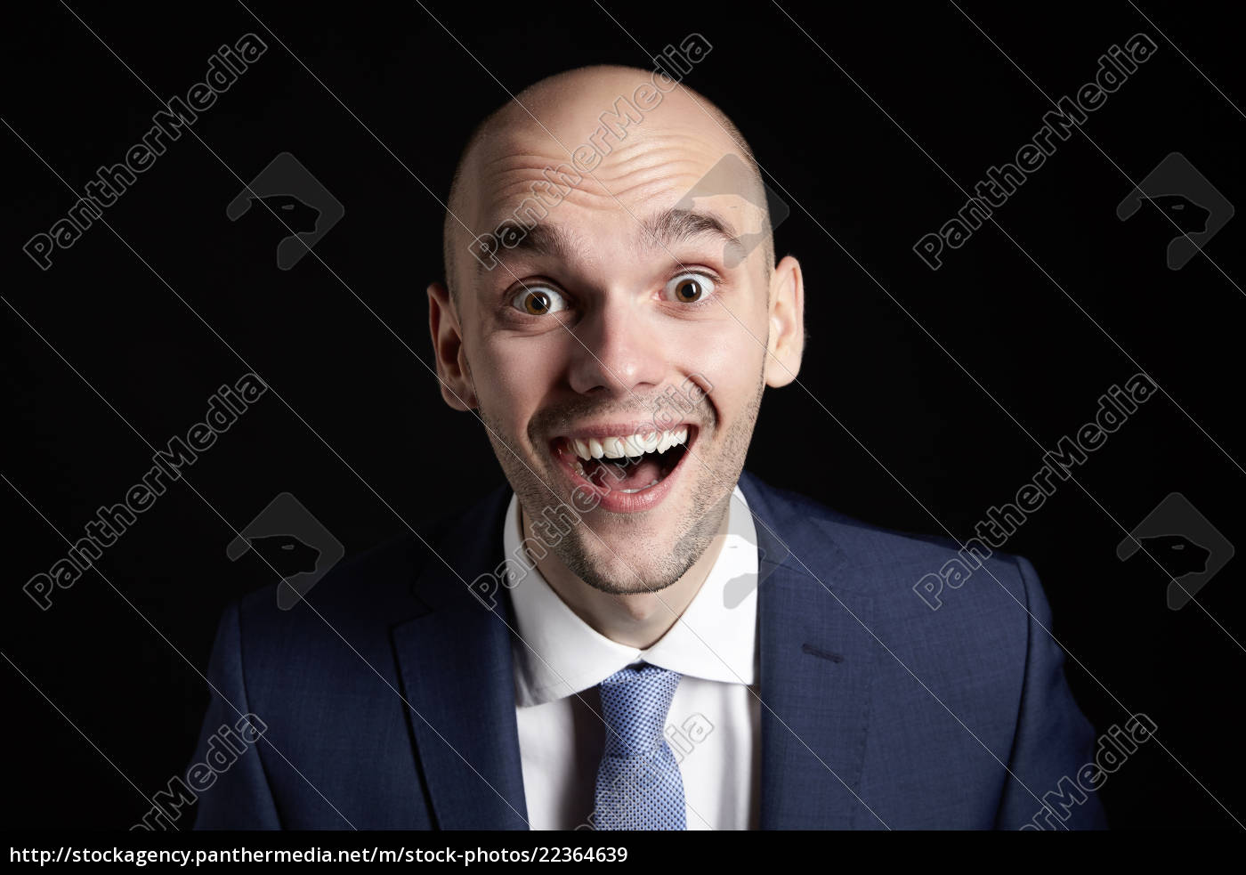 happy, man, in, suit - 22364639