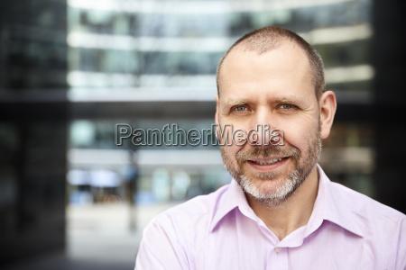 pleasant man in pink shirt
