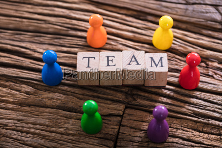 team word on wooden block with