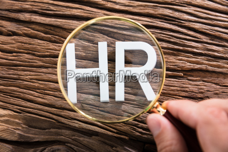 person looking at hr text through