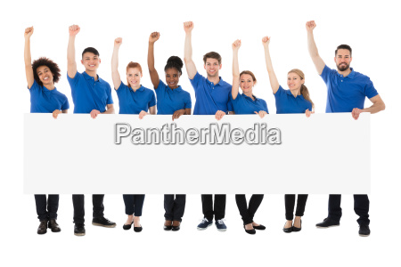 happy multiracial janitors with banner