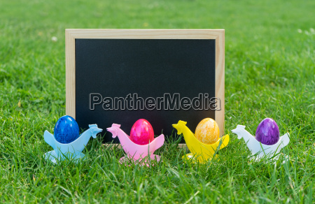 colorful easter eggs with chalkboard