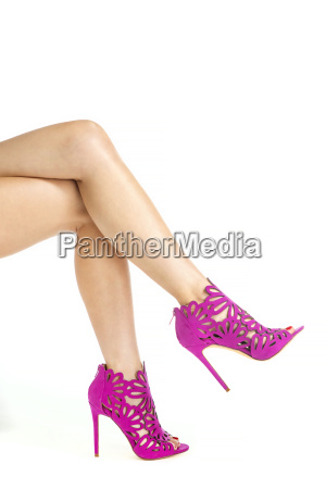 legs with high heels ankle boots