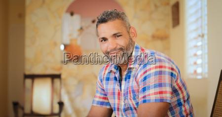 portrait happy gay man looking at