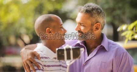 gay couple two men taking selfie