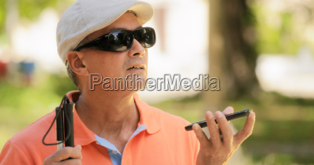 blind man talking with mobile phone