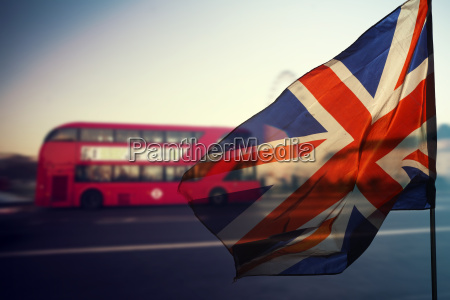 uk flag and typical red buses