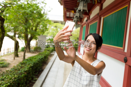 young woman taking selfie by mobile