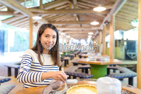 young woman having noodles in japanese