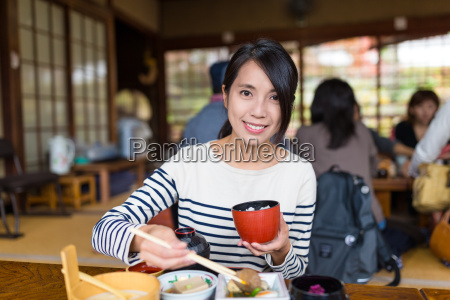 young woman enjoy japanese meal in