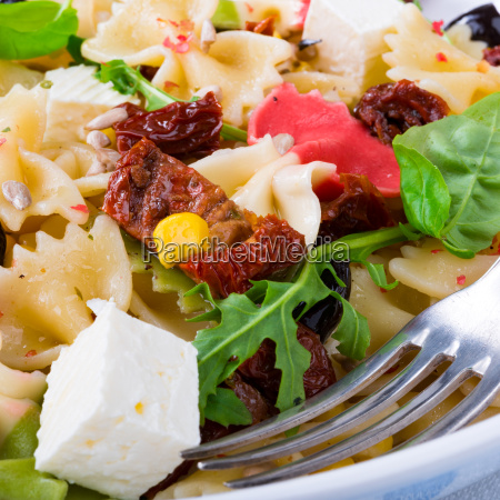 mediterranean farfalle with tomatoes and pine