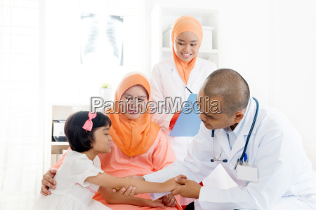 asian medical doctor and patient