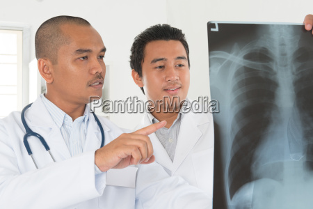 medical doctors checking on x ray