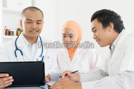 asian medical doctors meeting at hospital
