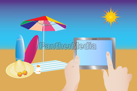 touching tablet at summer beach