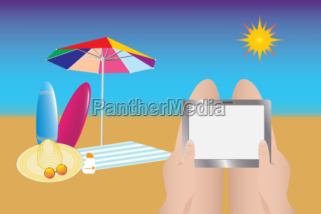 relaxing with tablet at summer beach