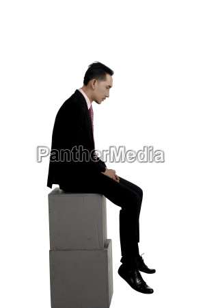 asian business man feeling sad sitting