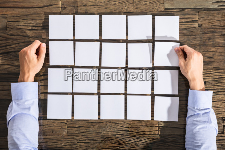 businessman with adhesive notes on desk