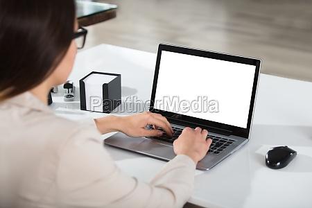 businesswoman using laptop at desk