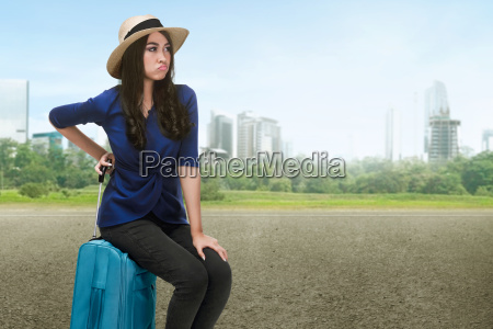 traveler asian woman with hat sitting