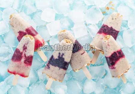 popsicles with berries granola and chia