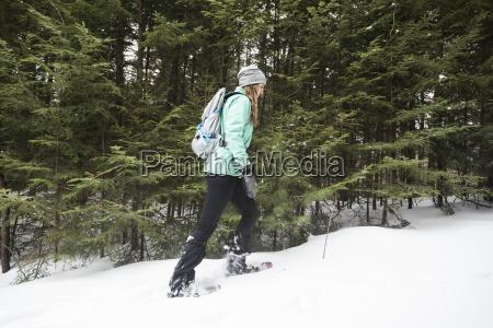 woman walking in woods in winter