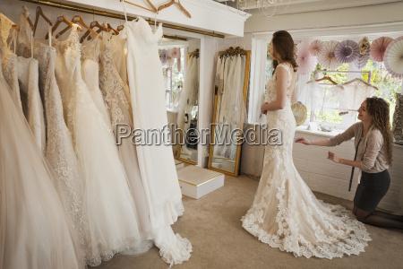 rows of wedding dresses on display