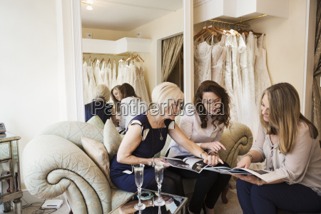 three women in a wedding dress