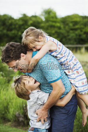 a father and two children in