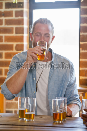 drunk male customer standing at bar