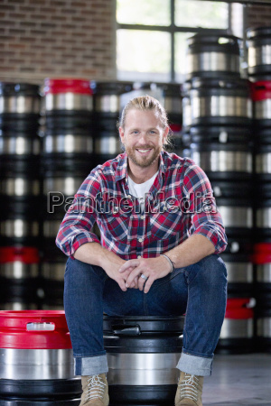 portrait of brewery worker sitting on