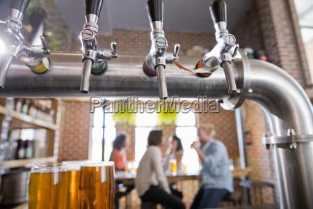 close up of bar beer pumps