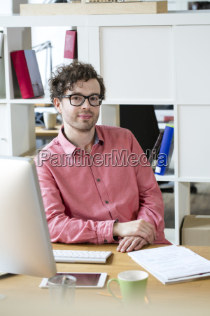 portrait of confident man sitting at