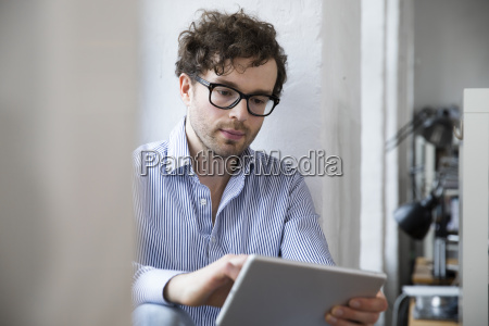 man using tablet in office