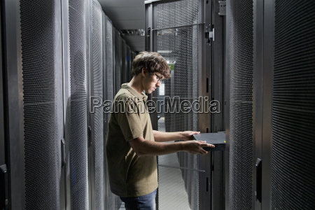 service technician working on data switch