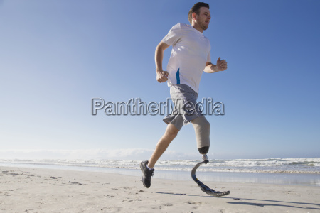 man with blade style artificial leg