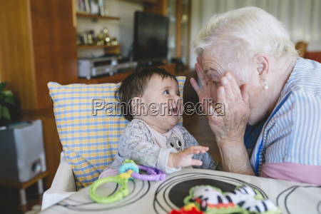 happy great grandmother playing with a