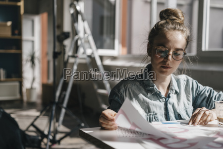young woman at table working on