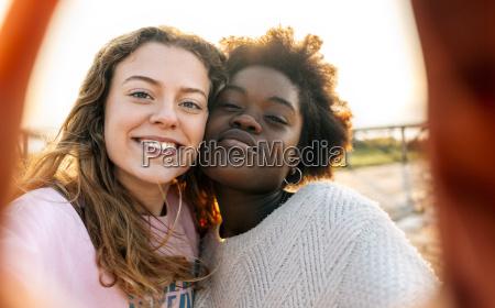 two best friends making a selfie