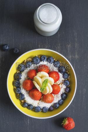 bowl of spelt pops with blueberries