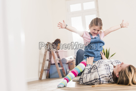 happy mother and daughter playing in