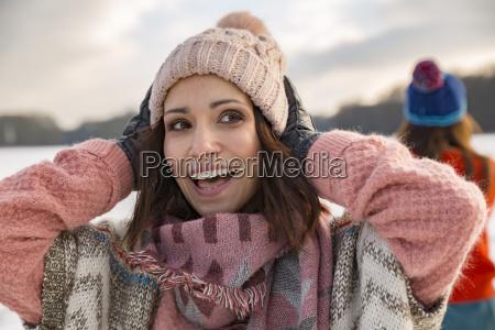 happy woman holding her woolen hat