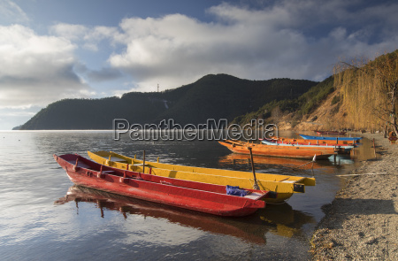 boats on lugu lake lige village
