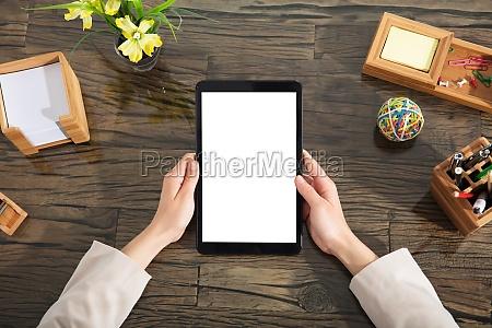 businessperson holding blank digital tablet
