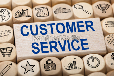 customer service text on wooden block