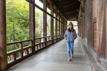 woman walking in japanese old house