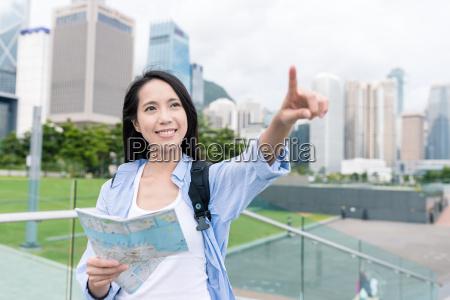 woman using city map in hong