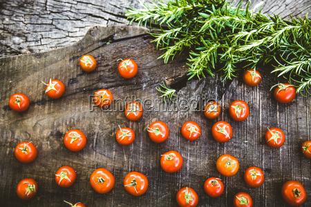 fresh tomatoes on wood